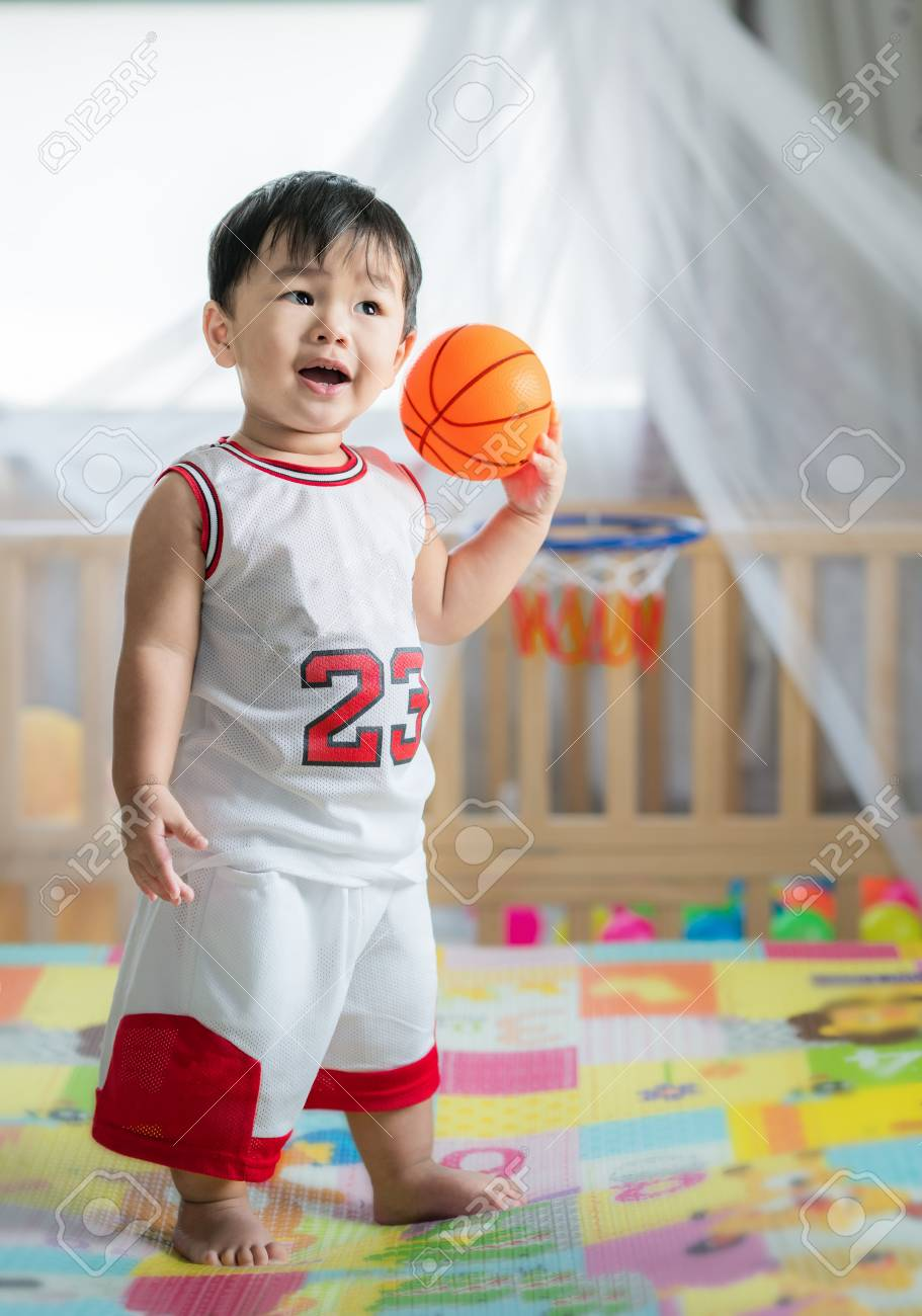 116523782-baby-with-ball-in-basketball-uniform-this-immage-can-use-for-play-sport-baby-child-k...jpg